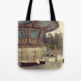 Carousel in the amusement park Tote Bag