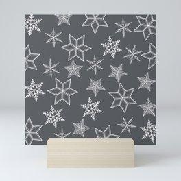 Simple Snowflakes On Grey Background Mini Art Print
