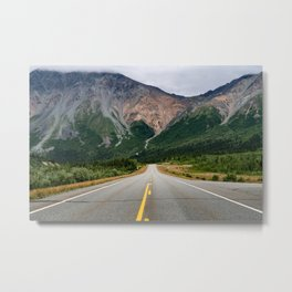View of the Richardson Highway near Delta Junction Alaska. Empty road in the middle of the highway. Metal Print