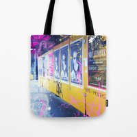alisa burke Tote Bags featuring purple and yellow _  little burke graffiti by Vin Zzep