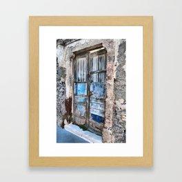 Old blue door Framed Art Print