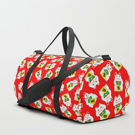 Three Wise Lucky Cats on Red Duffle Bag