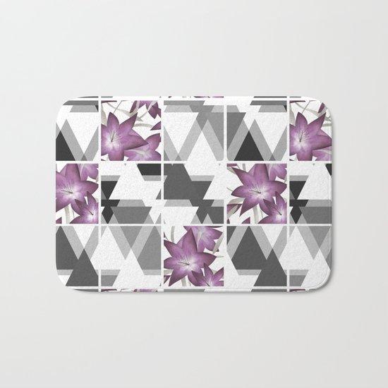Pink lilies on grey triangles . Bath Mat