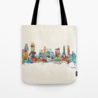 san diego Tote Bags featuring San Diego California skyline by bri.buckley