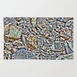 the rock wall Rug