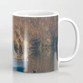 Fisherman on a boat by the river in the early morning Coffee Mug