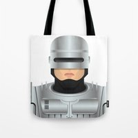 robocop Tote Bags featuring Robocop by Capitoni