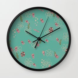 Jellyfish swimming through seaweed Wall Clock