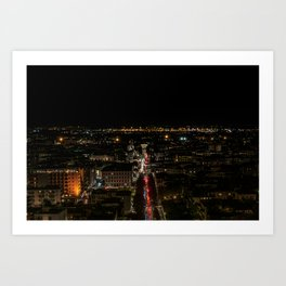 Night view of the illuminated city, the trails of car lights cut the scene in two Art Print