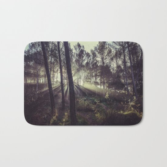 """Forest dreams"". Sunrise through the foggy forest Bath Mat"