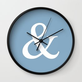 Ampersand sign on placid blue color background Wall Clock