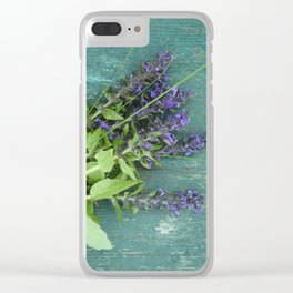 Bouquet of violet flowers on a painted green bench Clear iPhone Case