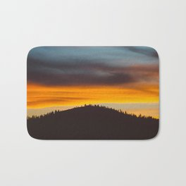 Mountain Hill With Trees Orange And Blue Sunset Clouds Bath Mat