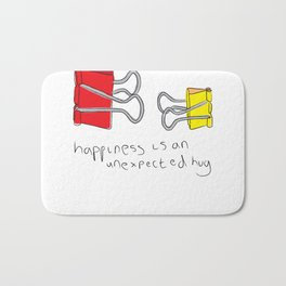 Happiness is an unexpected hug Bath Mat
