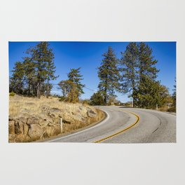 Empty Highway Road Cutting through Pine Trees and Golden Meadow in Lake Cuyamaca Rug