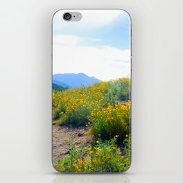 yellow poppy flower field with green leaf and blue cloudy sky in summer iPhone Skin