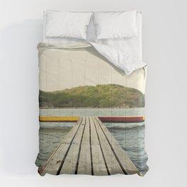 Pier in Caribbean lake Comforters