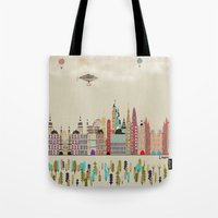 england Tote Bags featuring visit london england by bri.buckley