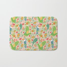 Turquoise toucan with green cockatoo amoung exotic fruits Bath Mat