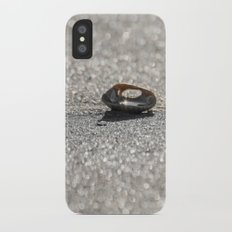 Sun Reflected in a Shell on a Sparkling Sandy Beach iPhone X Slim Case