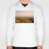 hot air balloons Hoodies featuring Hot Air Balloons Over Landscape by Limitless Design
