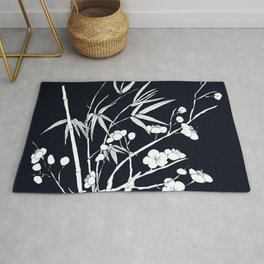 bamboo and plum flower white on black Rug