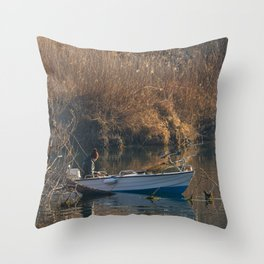 Fisherman on a boat by the river in the early morning Throw Pillow