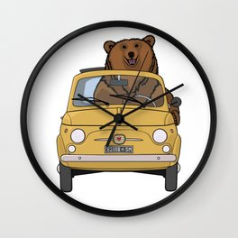 A brown bear riding a yellow convertible Wall Clock