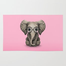 Cute Baby Elephant Calf with Reading Glasses on Pink Rug