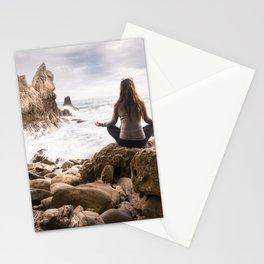 Meditating woman on rocky beach Stationery Cards