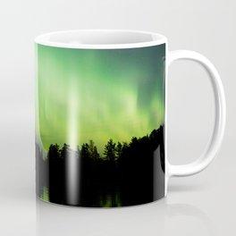 Northern lights glowing over lake Coffee Mug