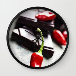 Dark chocolate with chili pepper over wooden background Wall Clock