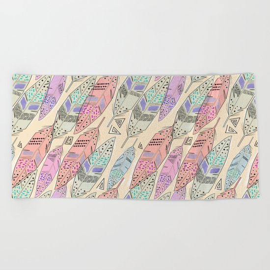 The feathers are multicolored on a beige background . Beach Towel