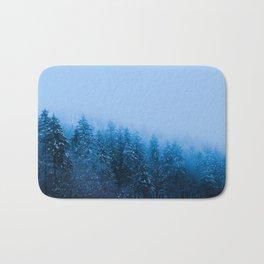 Fog over snow covered forest at lake Bohinj, Slovenia Bath Mat