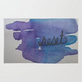 reset watercolor print Rug
