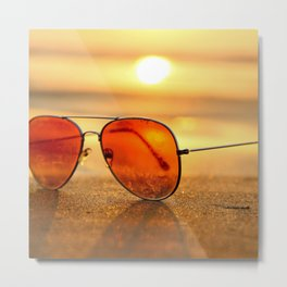 Red Lens Sunglasses on Sand Near Sea at Sunset Metal Print