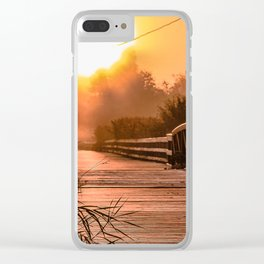 A beautiful sunrise view from a park footbridge Clear iPhone Case