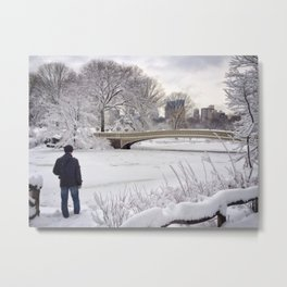 A man looking out over a frozen lake in New York City's Central Park on a winter day Metal Print