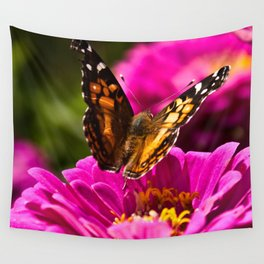 A butterfly flaps its wings Wall Tapestry