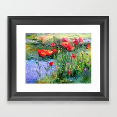 Poppies in a field near a pond Framed Art Print