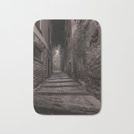 Medieval street that goes up narrow towards Bergamo Alta in the night Bath Mat