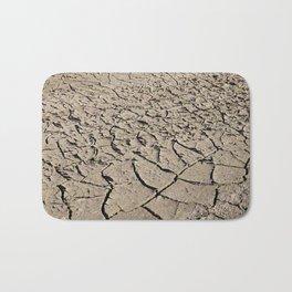 cracked earth close up Bath Mat