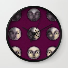 moon phases on dark purple Wall Clock