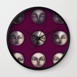 moon phases on dark purple Wall Clock