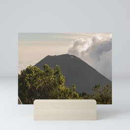 above the clouds looking at the volcano  Mini Art Print