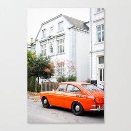 Car and orange Canvas Print