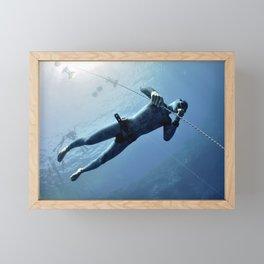 Freediver makes preparation dive Framed Mini Art Print