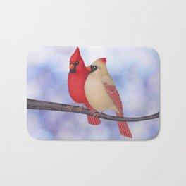 northern cardinals (bokeh) Bath Mat