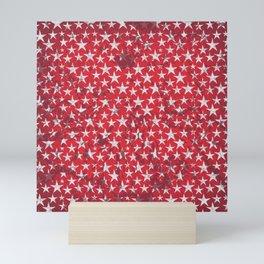 White stars on red grunge textured background Mini Art Print