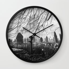 Rural church and graveyard in early morning fog. Hilborough, Norfolk, UK. Wall Clock